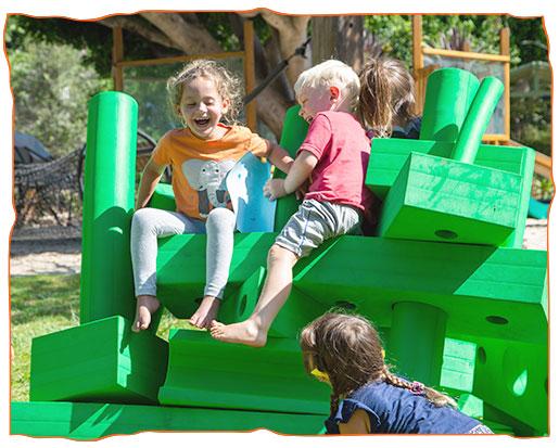 green blocks with children