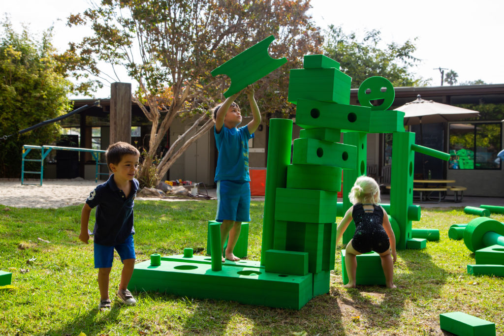 kids playing with bright day big blocks
